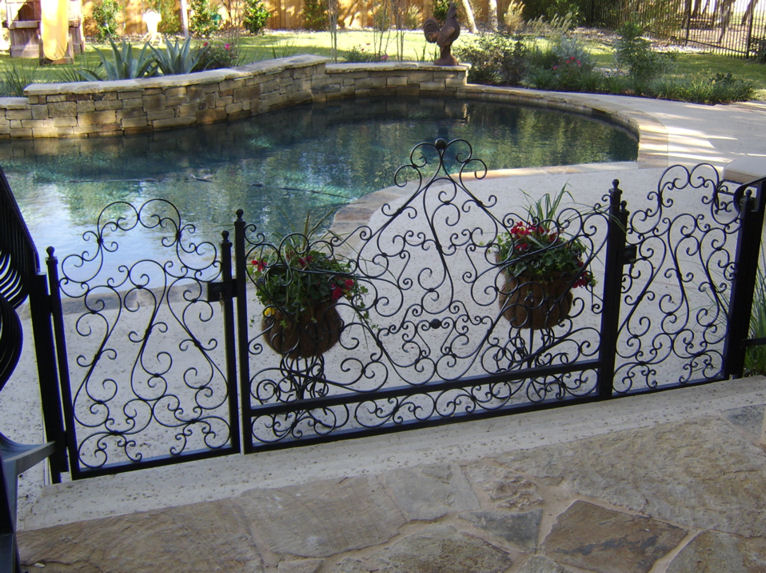 iron pool gates with fencing - weaver creative - evans weaver